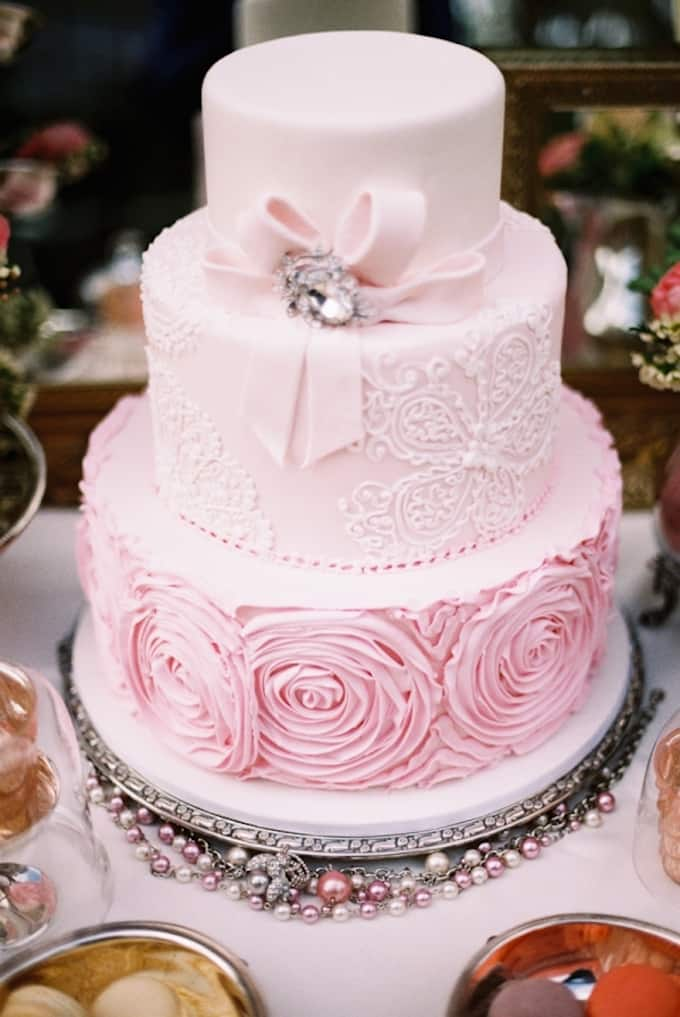 Pink and black castle wedding cakes