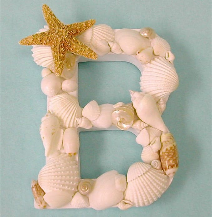seashell-adorned letter