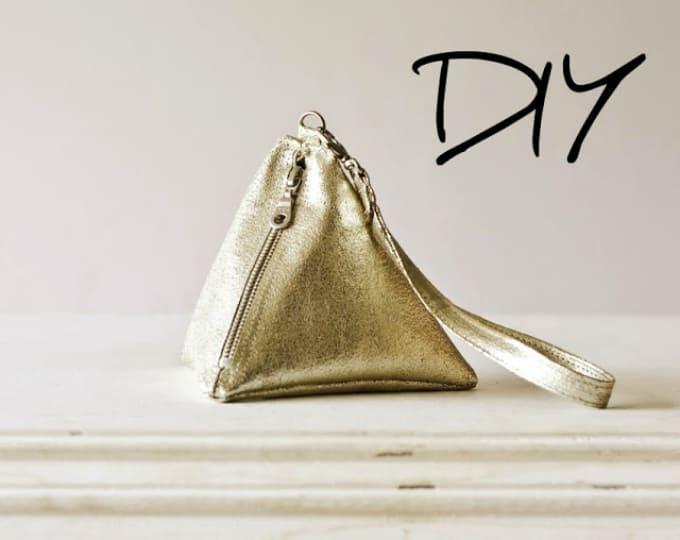 pyramid leather wrist bag