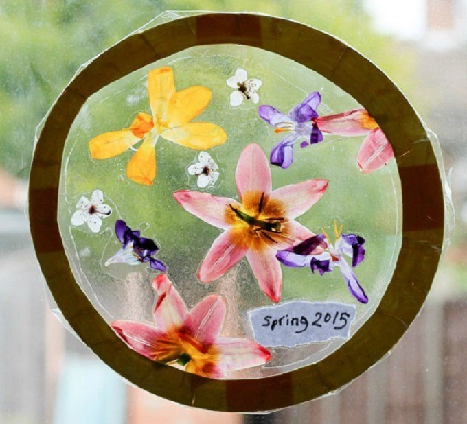 Pressed Flower Sun Catcher - We compiled a list of 39 other DIY pressed flower ideas for you to make | Coolcrafts.com