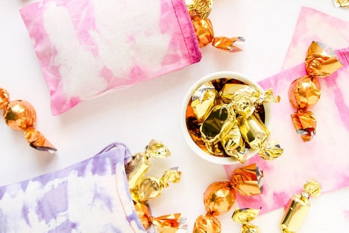 Dyed Favor Bags - Check out 34 other eye-catching goodie bag ideas that you can make for your next party.   Coolcrafts.com