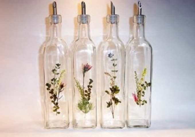 Pressed Flower Bottles - We compiled a list of 39 other DIY pressed flower ideas for you to make | Coolcrafts.com