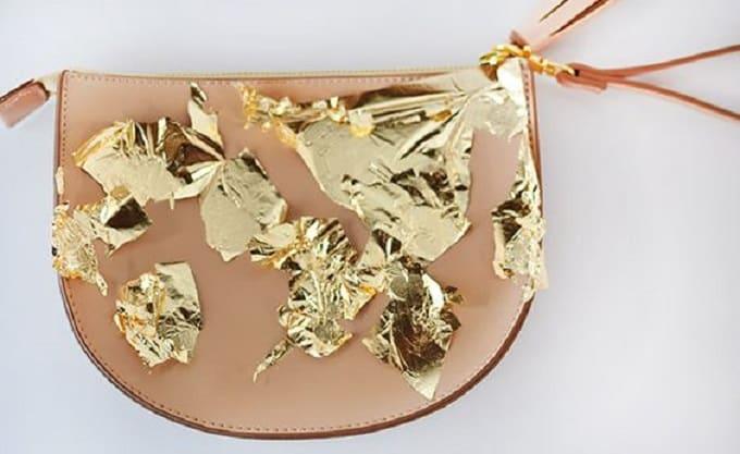 gold foil brushstroke clutch