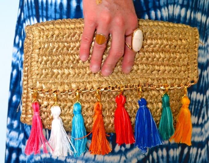 tassels to a straw clutch bag