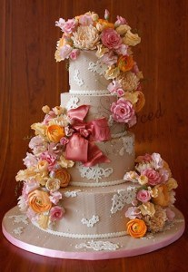 lace and cascading florals wedding cake