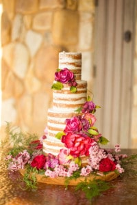 naked wedding cake with florals