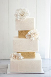 white lace wedding cake with gold