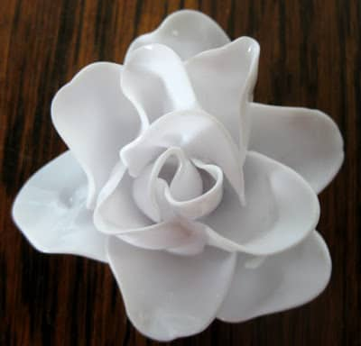 melted plastic spoons rose