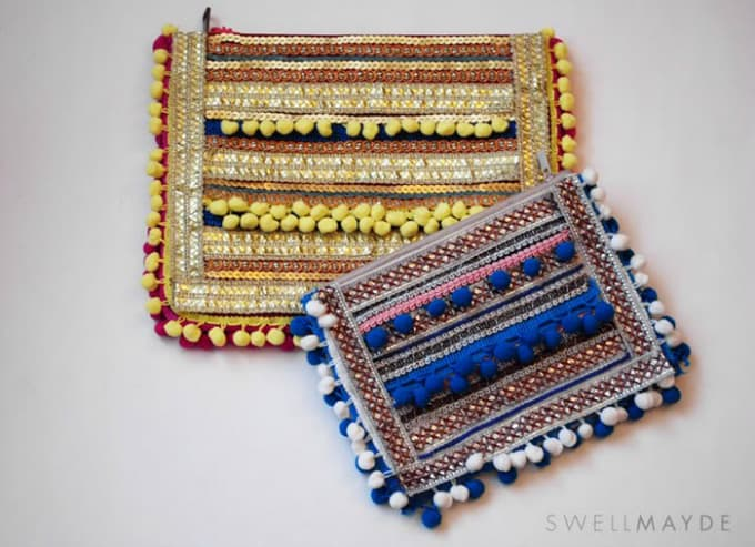 pom pom adorned clutch