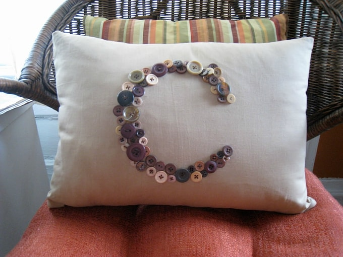 button monogram pillow