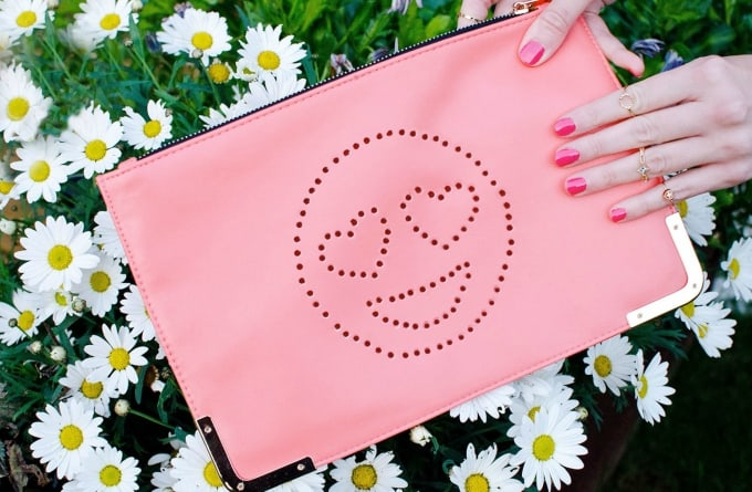 perforated emoji clutch