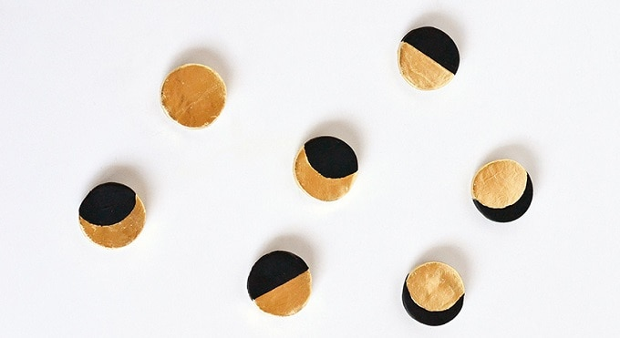 gold foil and black circular magnets